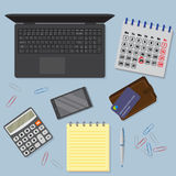View of office desk background including laptop, digital devices, financial and business objects. Stock Image