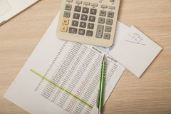 View of the office desk, calculations and notes, top view royalty free stock photo