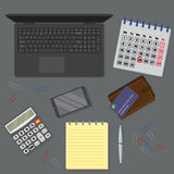View of office drak desk background including laptop, digital devices, financial and business objects. Stock Photography