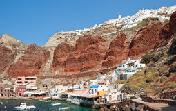 View of Oia. With harbour and red volcanic land, Santorini, Greece Stock Photo