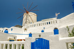 View of oia in santorini with an old mill Royalty Free Stock Image