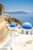View of oia in santorini and part of caldera, blue church Stock Photo