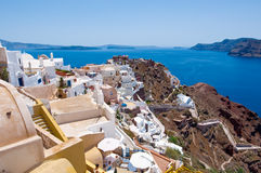 View of Oia town and the castle of Oia towards Thirassia, Thera (Santorini),Greece. Royalty Free Stock Photo