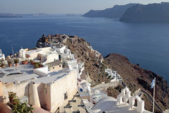 View of Oia town and old castle of Oia, Santorini, Greece. Stock Photo