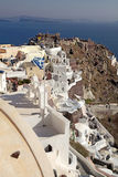 View of Oia town and old castle of Oia, Santorini, Greece. Royalty Free Stock Images