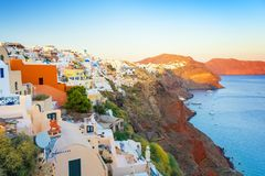 View on Oia town in Santorini island during sunset, Cyclades, Greece Royalty Free Stock Photos