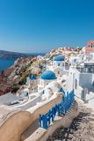 View of Oia town with traditional and famous houses and churches with blue domes over the Caldera on Santorini island. Greece royalty free stock photos