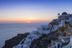 View of Oia traditional white houses of Oia at sunset in Santori Royalty Free Stock Photos