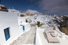View of Oia traditional white houses and old castle of Oia, Sant Royalty Free Stock Image