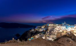 Oia village by night - Aegean sea - Santorini island - Greece. View of Oia village by night - Aegean sea - Santorini island - Greece stock photo
