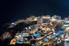 Oia village by night - Aegean sea - Santorini island - Greece. View of Oia village by night - Aegean sea - Santorini island - Greece royalty free stock photos