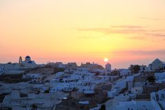 Sunset in Oia village, Santorini island. View of Oia village in Santorini island, Greece, during a summer time sunset Royalty Free Stock Images