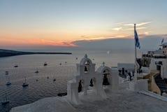 Oia village at the sunset - Aegean sea - Santorini island - Greece. View of Oia village at the sunset - Aegean sea - Santorini island - Greece stock photos