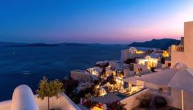 Oia village at the sunset - Aegean sea - Santorini island - Greece. View of Oia village at the sunset - Aegean sea - Santorini island - Greece royalty free stock image