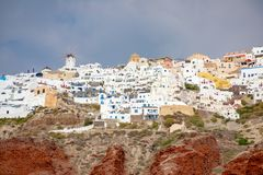 View of Oia village with white houses on red rocks caldera of Santorini Island, Greece. View of Oia village with white houses on red rocks caldera of Santorini stock image