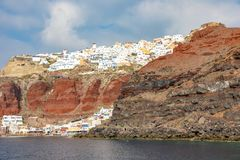 View of Oia village with white houses on red rocks caldera of Santorini Island, Greece. View of Oia village with white houses on red rocks caldera of Santorini stock images
