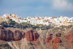 View of Oia village with white houses on red rocks caldera of Santorini Island, Greece. View of Oia village with white houses on red rocks caldera of Santorini royalty free stock photos