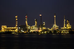 View of oil refinery industry plant in the night and river. Royalty Free Stock Image