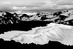View from Ok Vulcano to the snowfields of Thorisdalur. Iceland. Unreal view from the vulcano Ok with its snow-filled crater to the snowfields and glaciers of Royalty Free Stock Images