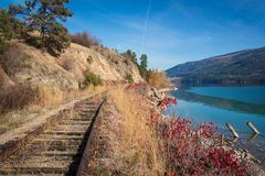 Okanagan railway near the lake kelowna British Columbia Canada. View of okanagan lake British Columbia railway Royalty Free Stock Image