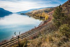 Okanagan railway near the lake kelowna British Columbia Canada. View of okanagan lake British Columbia railway Royalty Free Stock Photo
