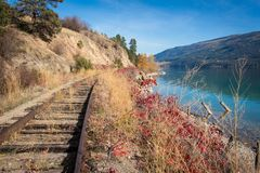 Okanagan railway near the lake kelowna British Columbia Canada. View of okanagan lake British Columbia railway Stock Image