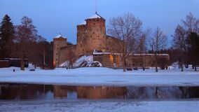 View of the Olavinlinna fortress in March twilight. Savonlinna, Finland. View of the Olavinlinna fortress in March twilight. Savonlinna. Finland stock footage