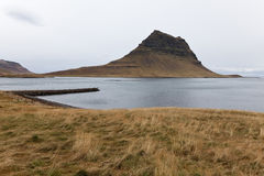 View of the Olavsvik bay with a small dock. View of the Olavsvik bay with a small dock, Iceland Royalty Free Stock Photos