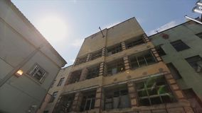 View of old abandoned building without glass in windows. Rust. Dilapidated walls. Pipers stock video