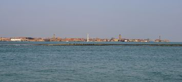 View on an old abandoned glass factory on the island of Murano from the Venice lagoon, Italy. Stock Photo