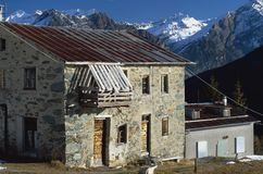 Old farmhouse in the Alps. View of an old alpine house in a wintry landscape Stock Images