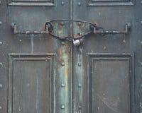 View of an Antique Door locked with Rustic Vintage Padlock. View of an old Antique Door locked with Rustic Vintage Padlock stock image