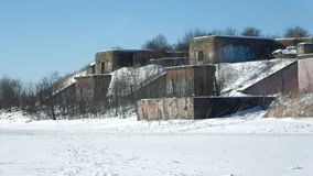 View of the old artillery positions of the 1st North of the Fort on a March day. Kronstadt, Russia. View of the old artillery positions of the 1st North of the stock footage