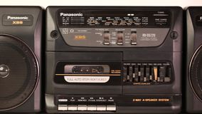 View of an old audio tape recorder isolated on background. Beautiful background. stock video footage