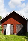 View of an Old Barn With a Square Shadow in Sweden With a Blue Cloudy Sky Stock Image
