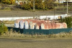 View of an old base of combustible lubricants. Barrels for storing gasoline. An old settlement. View of an old base of combustible lubricants. Barrels for stock photos