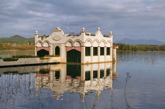 View of old bathhouse in Lake of Banyoles Stock Photo