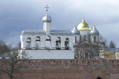 View of the old bell tower and domes of St. Sophia Cathedral. Veliky Novgorod. View of the old bell tower and domes of St. Sophia Cathedral, April day. Veliky royalty free stock photography