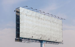 The view of old blank advertising billboard with blue sky backgr Royalty Free Stock Photos