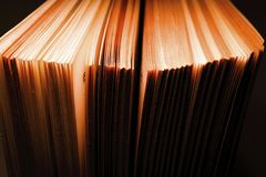 View of old book pages. Education and wisdom concept. Macro shot stock photography