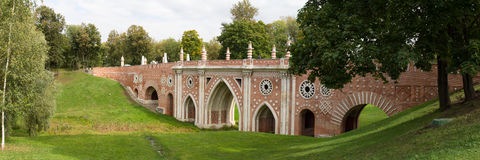 View of old bridge in Tsaritsyno Park. Autumn. Moscow. Russia. The photo was taken in Moscow. The panorama is pieced together from multiple photos. Autumn Royalty Free Stock Photography