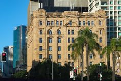 View of the old building in the CBD with modern skyscrapers behind it and palm trees in the foreground in Brisbane Queensland Aust royalty free stock images