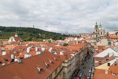View of Mala Strana in Prague. View of old buildings from above, Petrin Hill and St. Nicholas Church at the Mala Strana District Lesser Town in Prague, Czech Stock Images
