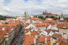 View of Mala Strana in Prague. View of old buildings from above, St. Nicholas Church and Prague Hradcany Castle at the Mala Strana District Lesser Town in Prague Stock Photo