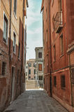 View of old buildings in an alley and bridge in Venice. Stock Photo