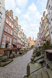 St. Mary`s Street in Gdansk. View of old buildings on the empty St. Mary`s Street ul. Mariacka and St. Mary`s Church at the Main Town Old Town in Gdansk, Poland Royalty Free Stock Images