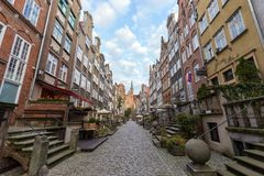 St. Mary`s Street in Gdansk. View of old buildings on the empty St. Mary`s Street ul. Mariacka and St. Mary`s Church at the Main Town Old Town in Gdansk, Poland Royalty Free Stock Image