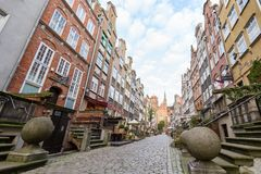 St. Mary`s Street in Gdansk. View of old buildings on the empty St. Mary`s Street ul. Mariacka and St. Mary`s Church at the Main Town Old Town in Gdansk, Poland Stock Photos