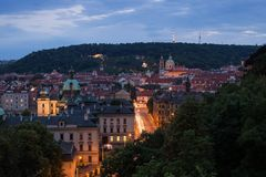 View of Mala Strana in Prague. View of old buildings at the Mala Strana District Lesser Town and Petrin Hill in Prague, Czech Republic, at dusk Royalty Free Stock Images