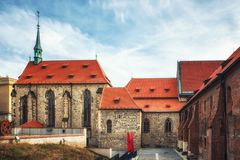 View of old buildings of monastery of Saint Agnes from Na Fratisku place on Dvorakovo embankment in Old Town of Prague, Czech Rep. Prague, Czech Republic - April royalty free stock photography